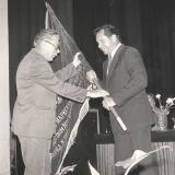 Переходящее красное знамя Министерства. Вручает заместитель Министра Горшков Николай Васильевич (слева)